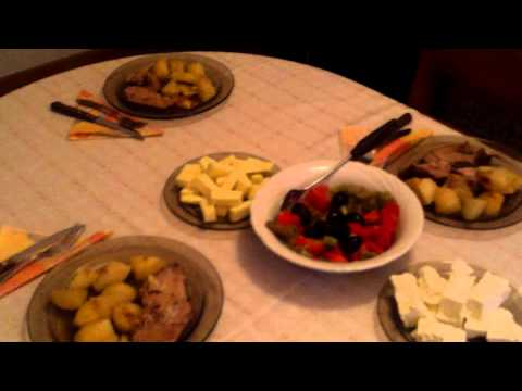 Setting up the table of Bulgarian dishes for dinner in Kravenik village in Bulgaria