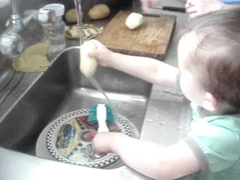 Laiken doing dishes and helping make dinner!!